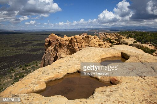 Pocket of water in rock formation depression : Stock Photo