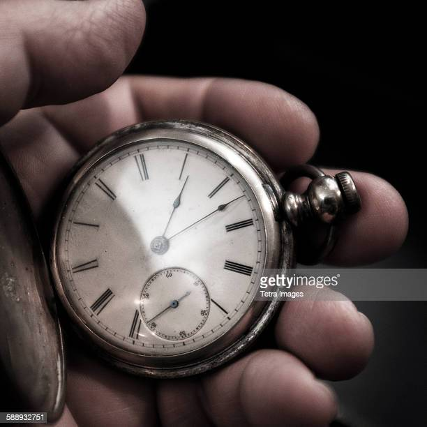 Pocket watch in mans hand