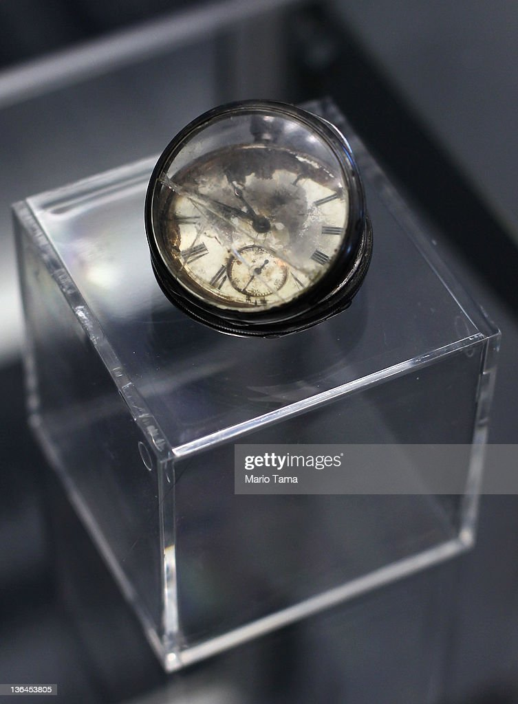 A pocketwatch is seen among artifacts recovered from the RMS Titanic wreck site at a press preview of a Titanic artifact auction at the Intrepid Sea, Air & Space Museum on January 5, 2012 in New York City. On April 11, 2012, the 100th anniversary of the maiden voyage of the Titanic, Guernsey's will auction the complete collection of more than 5,000 artifacts recovered from the Titanic wreck site.