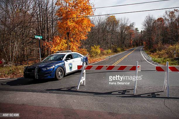 Pocono Police car sits on the route to the hangar where Eric Matthew was captured on Thursday night on October 31 2014 in Cresco Pennsylvania Frein a...