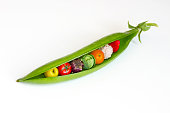 A pea pod containing fruits and vegetables