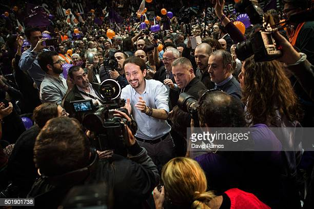 Podemos leader Pablo Iglesias waves as he arrives for a closing campaign rally on December 18 2015 in Valencia Spain Over 36 million Spaniards will...
