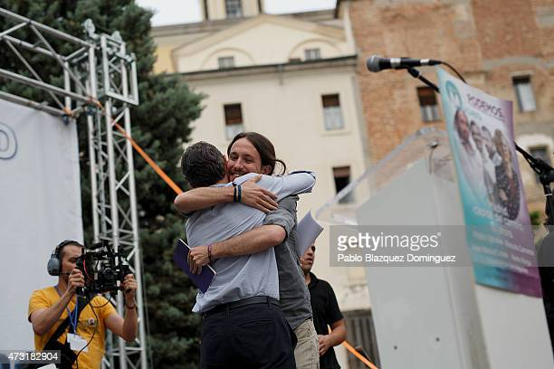 'Podemos' party leader Pablo Iglesias hugs his candidate for Madrid Comunity Jose Manuel Lopez during an election campaign rally at the Cornisa Park...