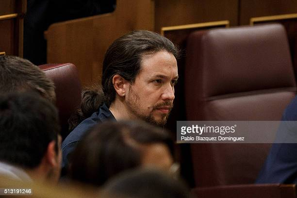 Podemos party leader Pablo Iglesias listens the speech of Spanish Socialist Party leader Pedro Sanchez during a debate to form a new government at...