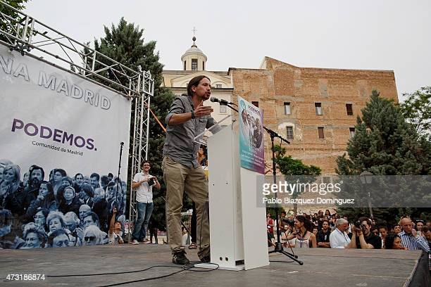 Podemos party leader Pablo Iglesias speaks to members of the public during an election campaign rally at the Cornisa Park on May 13 2015 in Madrid...