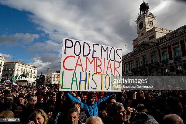 Podemos party supporter holds a placard reading 'We can change the history' at the end of a march on January 31 2015 in Madrid Spain According to the...