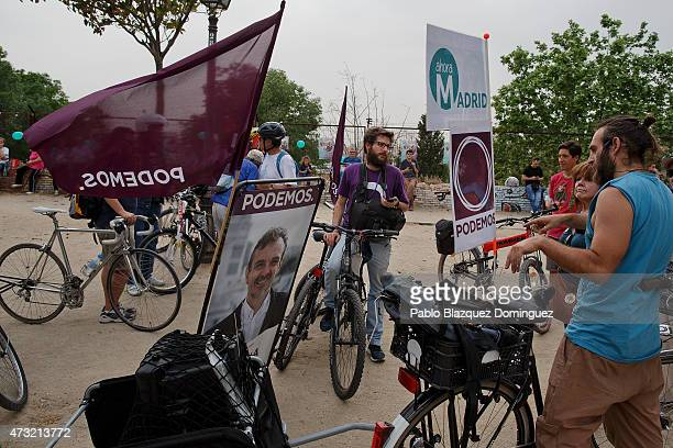 'Podemos' party volunteers arrive to a rally after advertising with their bikes the electoral campaign of 'Podemos' and 'Ahora Madrid' parties in...