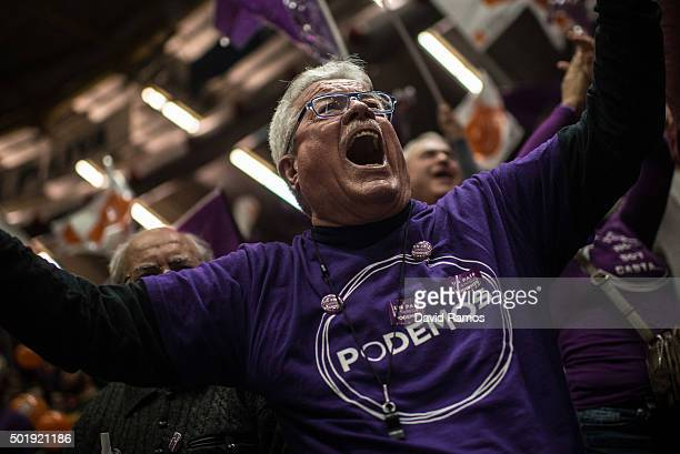 A Podemos supporter cheers during the closing campaign rally on December 18 2015 in Valencia Spain Over 36 million Spaniards will flock to the polls...