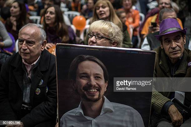 A Podemos supporter holds a portrait of Podemos leader Pablo Iglesias during the closing campaign rally on December 18 2015 in Valencia Spain Over 36...