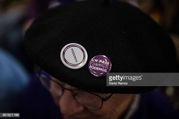A Podemos supporter wears a hat with Podemos badges as he attends the closing campaign rally on December 18 2015 in Valencia Spain Over 36 million...