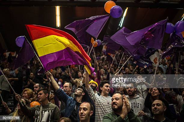 A Podemos supporters cheer and wave flags during the closing campaign rally on December 18 2015 in Valencia Spain Over 36 million Spaniards will...
