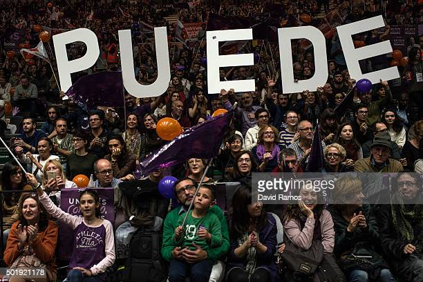 Podemos supporters cheer on and hold up letters that they read 'Puede' during the closing campaign rally on December 18 2015 in Valencia Spain Over...
