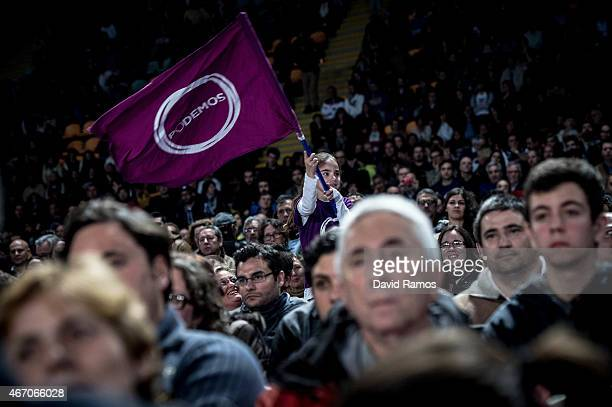 Podemos supporters listen to Podemos' leader Pablo Iglesias during a political campaign rally on March 20 2015 in Sevilla Spain Podemos the...