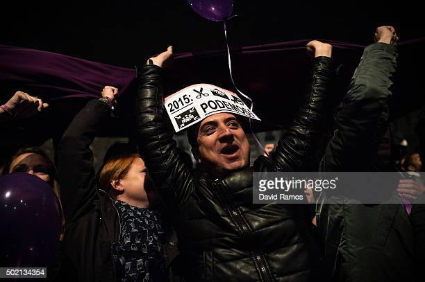 Podemos supporters reacts as their leader Pablo Iglesias delivers a speach on Spain General Elections' results on December 21 2015 in Madrid Spain...