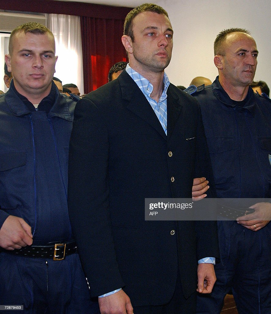 Damir Mandic (C), accused of murdering the editor-in-chief of Montenegro's main opposition daily newspaper, Dan, is escorted by court security officers, prior to a court session in Podgorica, 27 December 2006. Damir Mandic, 34, was the only suspect accused of shooting and killing Dusko Jovanovic, 40, outside the Dan offices in Podgorica in May 2004. He was acquitted due to lack of evidence. 'The prosecution failed to provide an argument proving that Mandic was in the car from which Jovanovic was shot,' the judge said. Jovanovic's family and colleagues packed the courtroom which was under tight security for the entire high-profile trial, as Jovanovic had been a strident critic of then prime minister Milo Djukanovic.