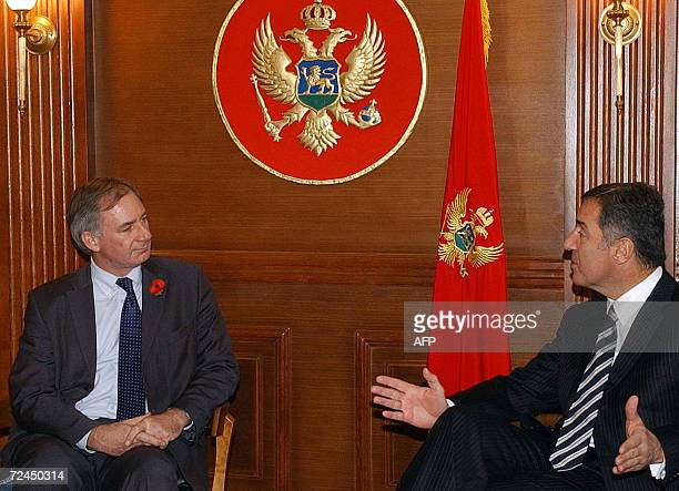 Montenegrin Prime Minister Milo Djukanovic talks to British Minister for Europe Geoffrey Hoon during their meeting in Podgorica 08 November 2006 AFP...