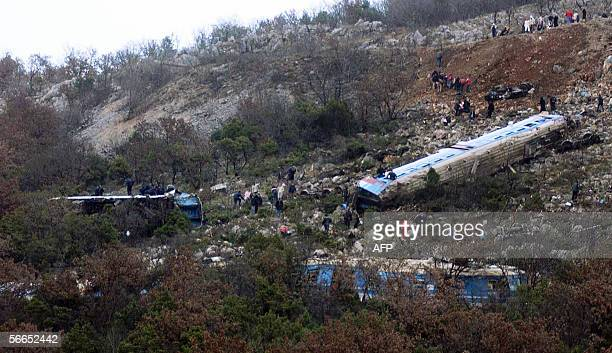 Montenegran rescuers search for injured passengers around the derailed train near Podgorica 23 January 2006 Thirty people were killed and more than...