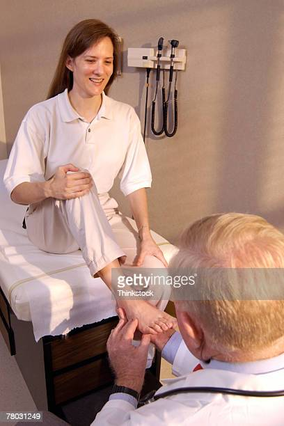 Podiatrist examining patient