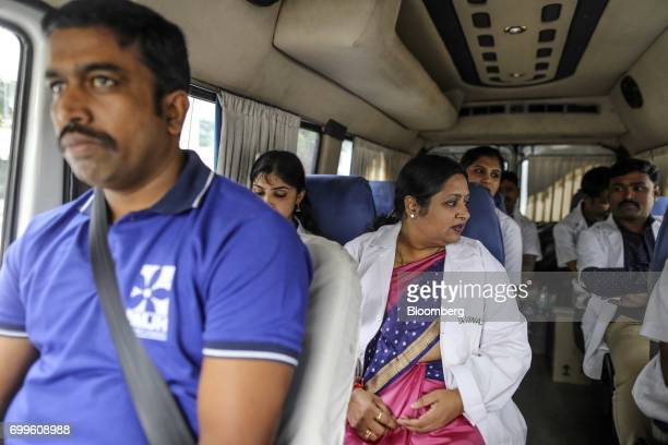 Podiatrist Vinaya AS center sits inside a vehicle with a team of medical staff from the Jain Institute of Vascular Sciences as they travel to...
