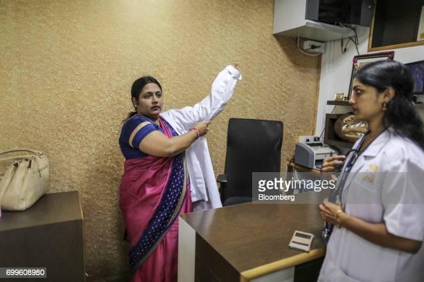 Podiatrist Vinaya AS left dons white coat inside the Jain Institute of Vascular Sciences center at Bhagwan Mahaveer Jain Hospital in Bengaluru India...