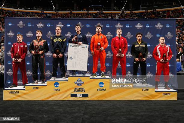 Podium of medal winners in the 165lb weight class during the Division 1 Men's Wrestling Championships held at Scottrade Center on March 18 2017 in St...