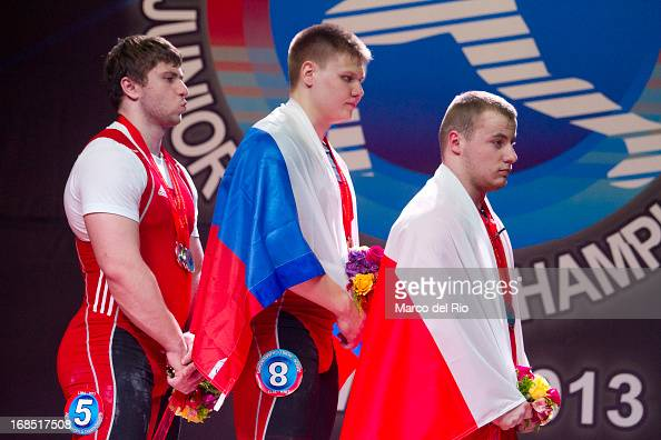 Podium of Men's 105kg Total during day seven of the 2013 Junior Weightlifting World Championship at Maria Angola Convention Center on May 10 2013 in...