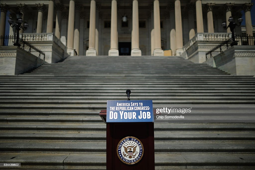 A podium with a printed slogan awaits Democratic members of Congress before they call on Republicans to postpone the Memorial Day holiday recess on the steps of the House of Representatives at the U.S. Capitol May 26, 2016 in Washington, DC. The Democratic leaders highlighted the need for 'action on the Zika virus, the opioid epidemic, the Flint water crisis and the president's nomination of Judge Merrick Garland to the Supreme Court.'
