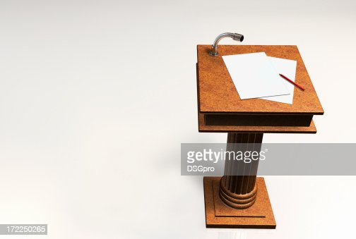A podium with notes and a pencil on top