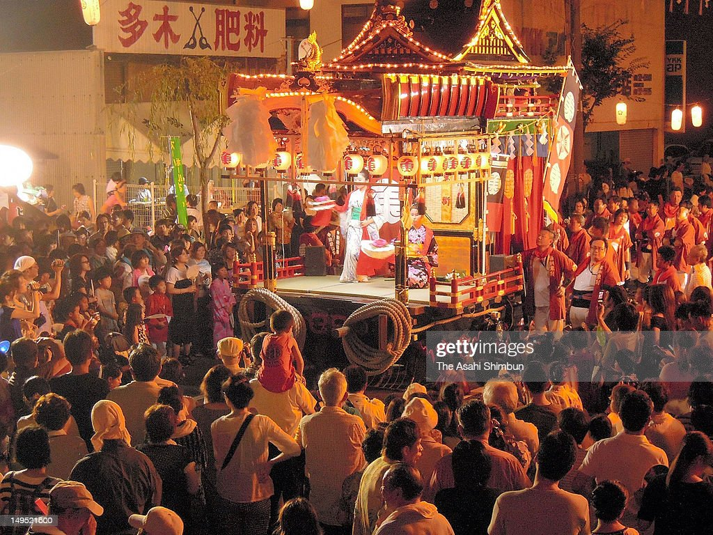 Poeple pull floats during the Nakatsu Gion festival continues on July 28, 2012 in Nakatsu, Oita, Japan.