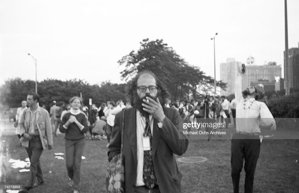 Poet Allen Ginsberg poses for a photo in Lincoln Park during the Democratic National Convention in August 1968 in Chicago, Illinois.
