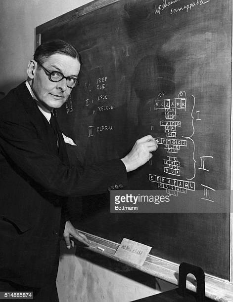 Poet and Nobel Prize winner TS Eliot draws a diagram of a new play in his office at the Institute of Advanced Study The Greek letters represent...