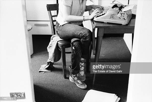 Poet and singer Patti Smith poses for a portrait at a typewriter on May 4 1971 at the Chelsea Hotel in New York City New York