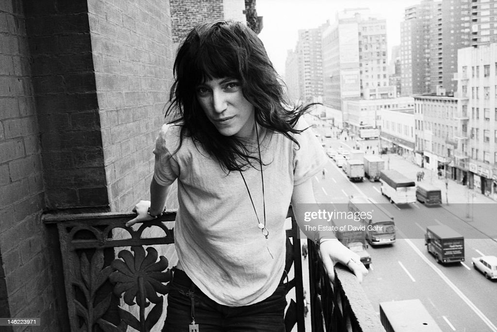 Poet and singer Patti Smith poses for a portrait on May 4, 1971 on a balcony at the Chelsea Hotel in New York City, New York.
