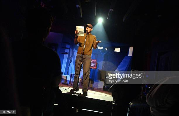 Poet Johnathan McClain reads his poetry at the Bowery Poetry Club December 6 2002 in New York City The Bowery Poetry Club which offers nightly poetry...