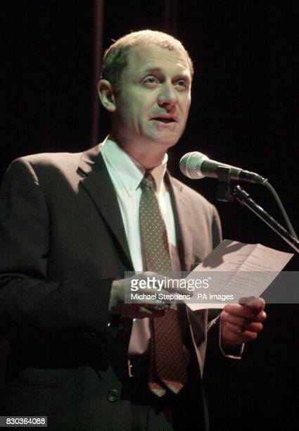Poet Laureate Andrew Motion reads a poetic tribute to former South African president Mr Mandela at the Peacock Theatre during Mr Mandela's lecture at...