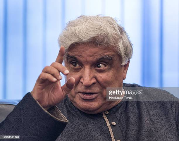 Poet lyricist and screenwriter Javed Akhtar interacts with Bollywood actor Amitabh Bachchan during an interaction session on the completion of 42...