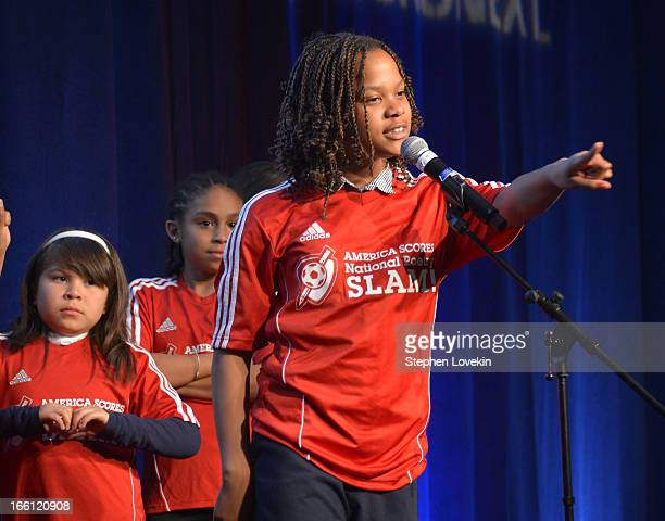 Poetathlete Anya S recites poetry onstage at The America Scores National Poetry Slam at New York Stock Exchange on April 8 2013 in New York City
