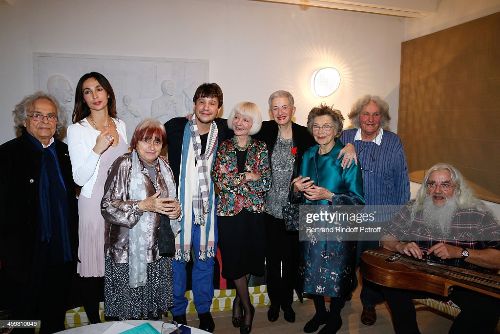 Poete Adonis, Julie Abdessemed, Photographer Agnes Varda, Contemporary artist Adel Abdessemed, Rector of the academic agency of 'Francophonie' Michele Gendreau-Massaloux, Literary criticism Helene Cixous, actress Emmanuelle Riva, Stage Director Ariane Mnouchkine and Artist creator of musical instruments Jean-Jacques Lemetre attend Helene Cixous receives Insignia of Officer of the Legion of Honor at the Home of Adel Abdessemed on November 20, 2014 in Paris, France.