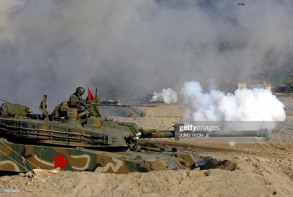 South Korean K-1 Tanks take part in a military drill in Pohang, some 374 Km southeast of Seoul, 27 October 2006. South Korea staged a military landing exercise amid the heightened tension over North Korea's nuclear test.