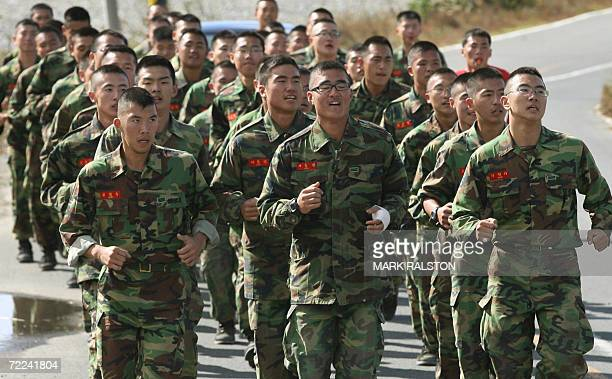 South Korean soldiers take a training run as they prepare for military exercises near the city of Pohang 23 October 2006 North Korea is willing to...