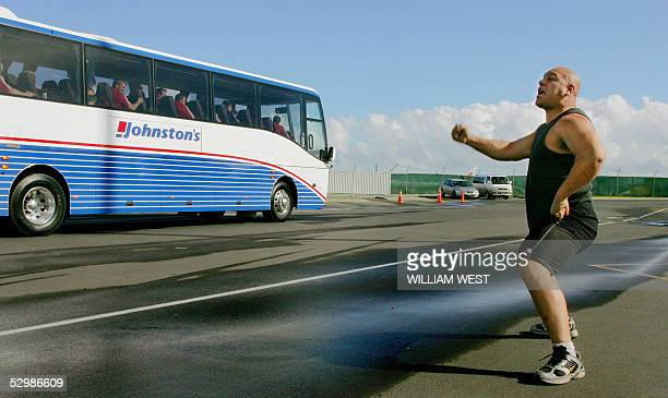 Pohatu Albert performs a 'haka' a traditional Maori challenge as the British and Irish Lions' bus departs after the team's arrival at Auckland...