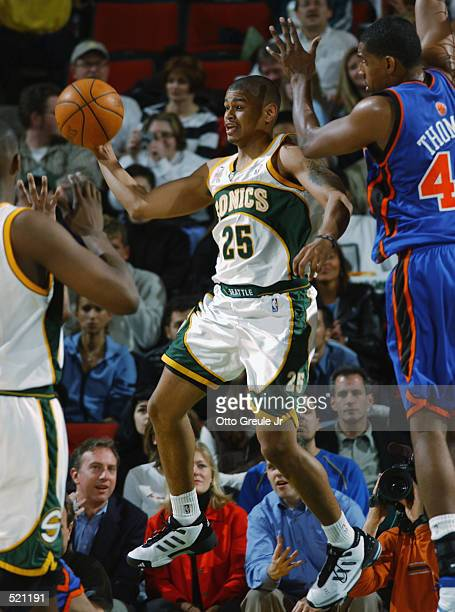 Point guard Earl Watson of the Seattle SuperSonics passes around forward Kurt Thomas of the New York Knicks during the NBA game at Key Arena in...