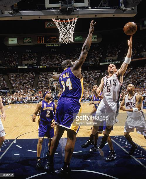 Point guard Jason Kidd of the New Jersey Nets shoots a jump shot over center Shaquille O'Neal of the Los Angeles Lakers during Game 3 of the 2002 NBA...