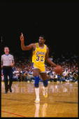 Point guard Magic Johnson of the Los Angeles Lakers dribbles the ball down the court during a game at the Great Western Forum in Inglewood California...