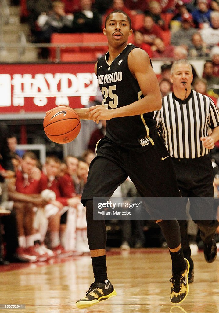 Point guard Spencer Dinwiddie #25 of the Colorado Buffaloes controls the ball during the game against the Washington State Cougars at Beasley Coliseum on January 19, 2013 in Pullman, Washington.