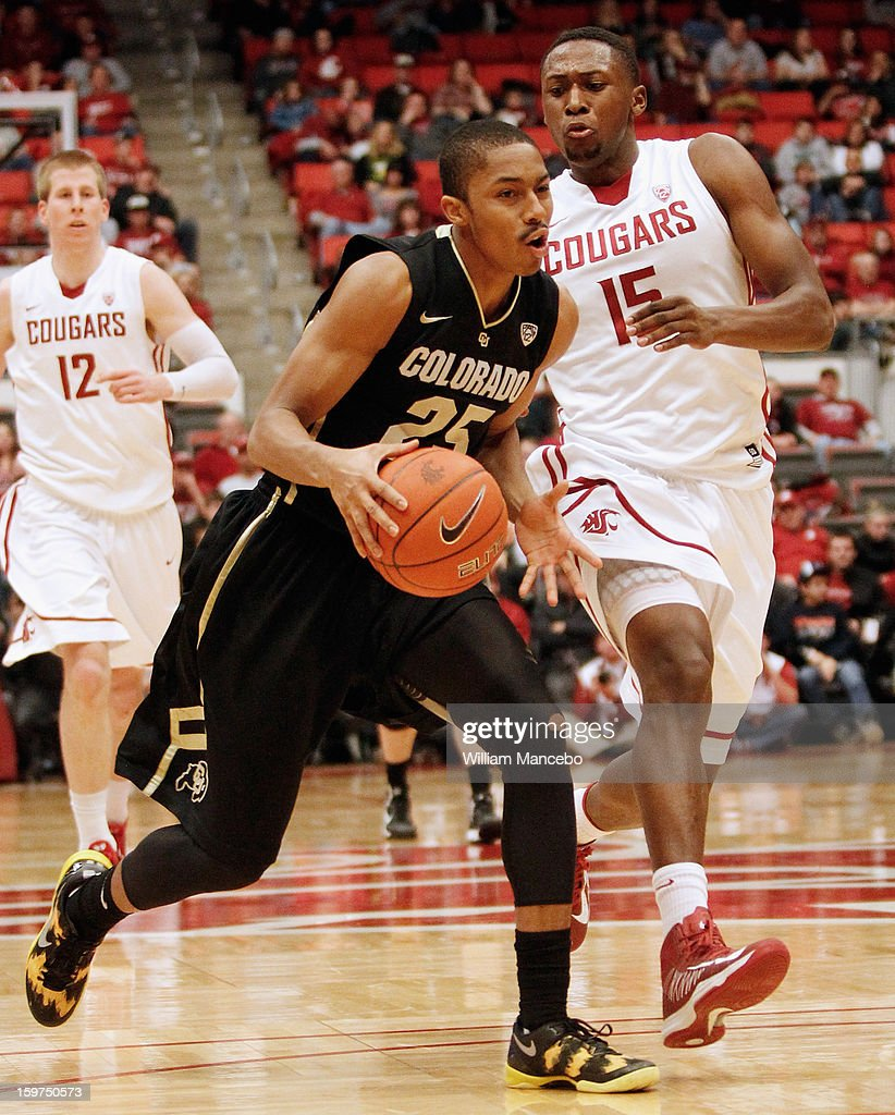 Point guard Spencer Dinwiddie #25 of the Colorado Buffaloes drives against forward Junior Longrus of the Washington State Cougars during the game at Beasley Coliseum on January 19, 2013 in Pullman, Washington.