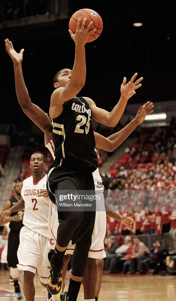 Point guard Spencer Dinwiddie #25 of the Colorado Buffaloes goes up for a goal attempt during the game against the Washington State Cougars at Beasley Coliseum on January 19, 2013 in Pullman, Washington.