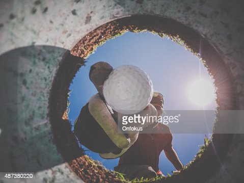 Point Of View Golf Player and Ball From Inside Hole