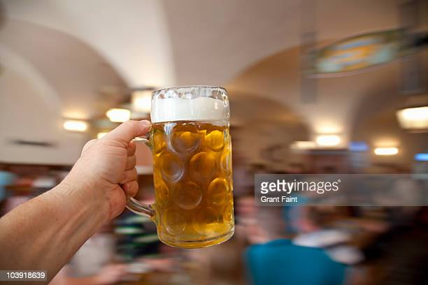 Point of View image of man holding beer.