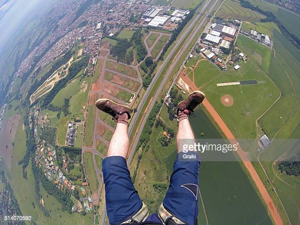 Point of view of legs skydiver flying